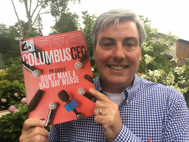 Holding a copy of this month's Columbus CEO magazine.