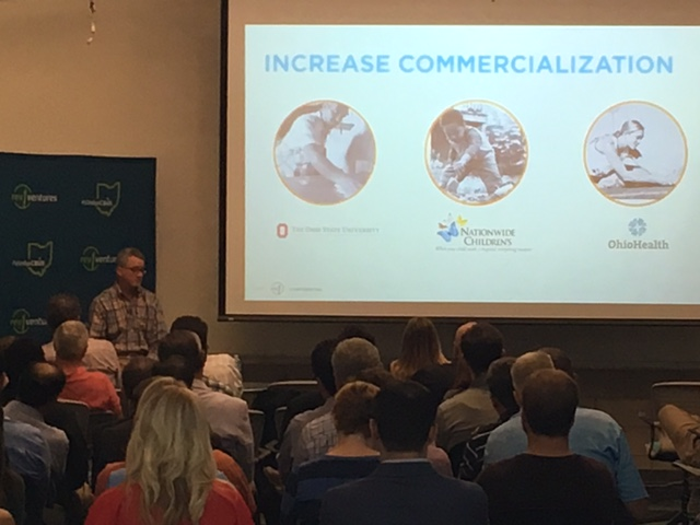 An overflow crowd was at Rev1 yesterday to hear CEO, Tom Walker speak (on left, elevated seat).
