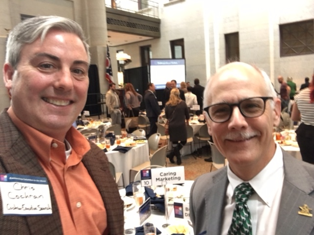 Dr. Paul Carringer, GCSCI Board Member and President, Caring Marketing and I at today's Annual Meeting. Please take notice of our strategic pose with the Caring Marketing sign on the table behind us. #marketingminds