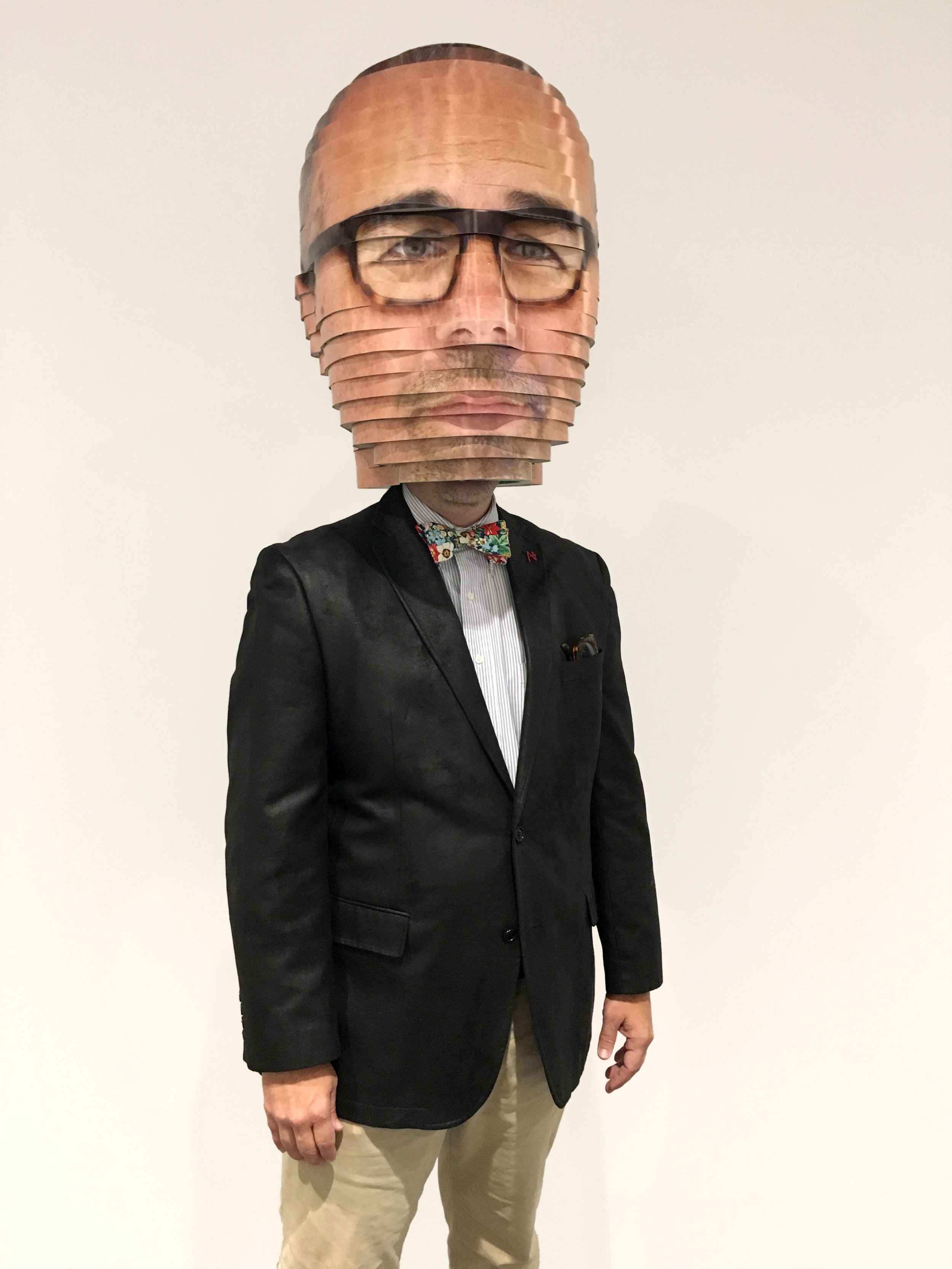 """Matthew Mohr, the artist behind the creation of the piece """"As We Are"""" is featured in this month's newsletter. He is pictured wearing a mini-replica of his own interaction with """"As We Are."""""""