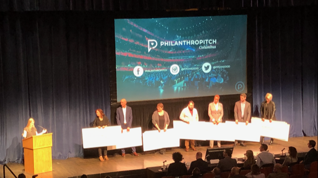 All of the finalists on stage with giant checks in their hands at last night's Philanthropitch Columbus.