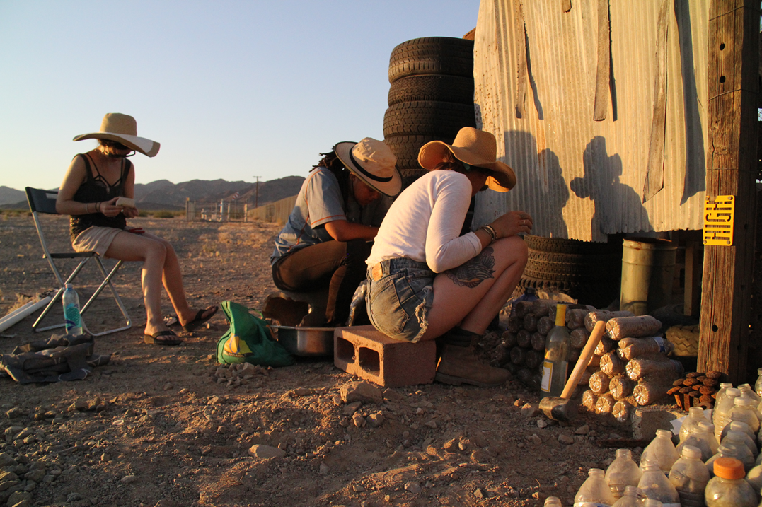 Participants work together to build an outdoor dry toilet