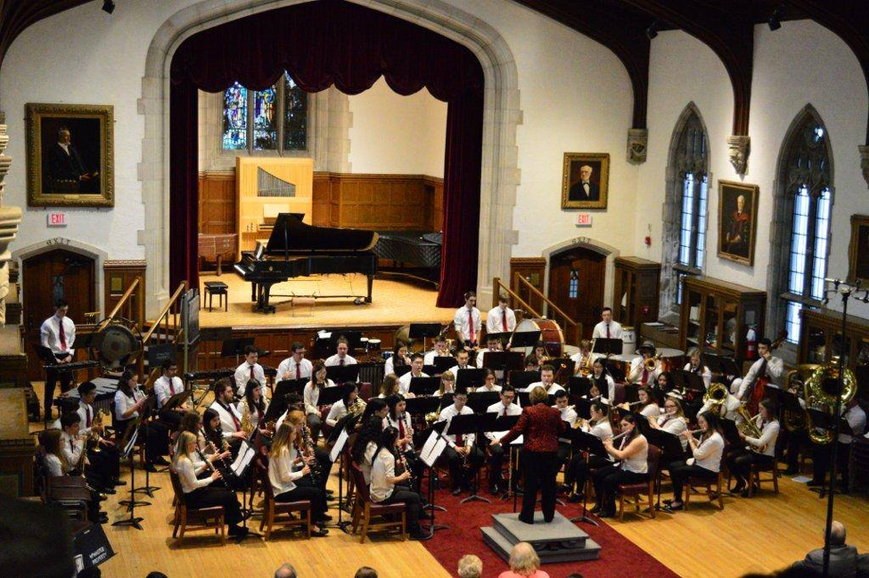 Figure       SEQ Figure \* ARABIC     1      : The seating arrangement for McMaster Concert Band, with the conductor on the center podium. Note the four rows of instrumentalists, as well as the Percussion section in the back. Photo by Mrs. Sideris.