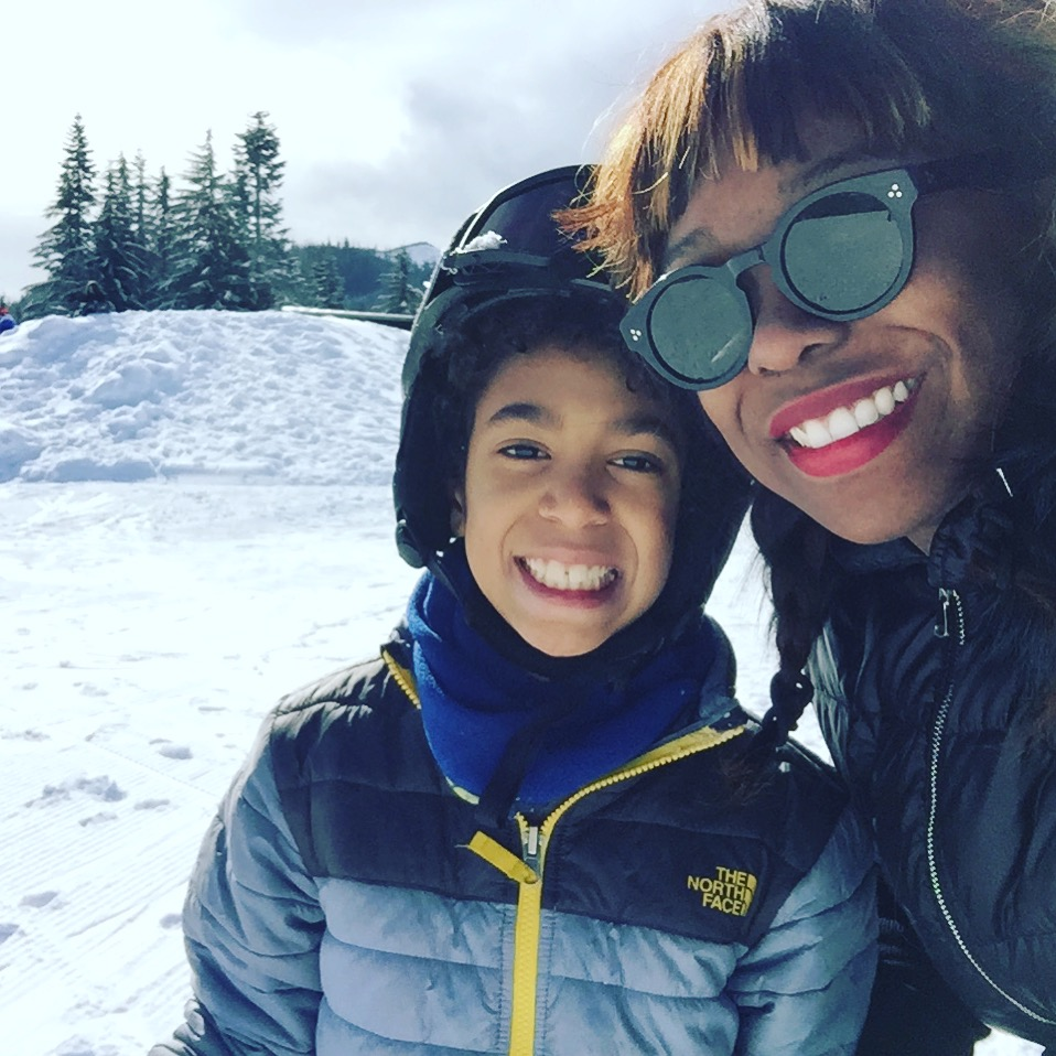 My son is in snow gear, because ya know, he's been skiing all day, I'm just wearing cute sunglasses and red llipstick, and taking in th scenery.
