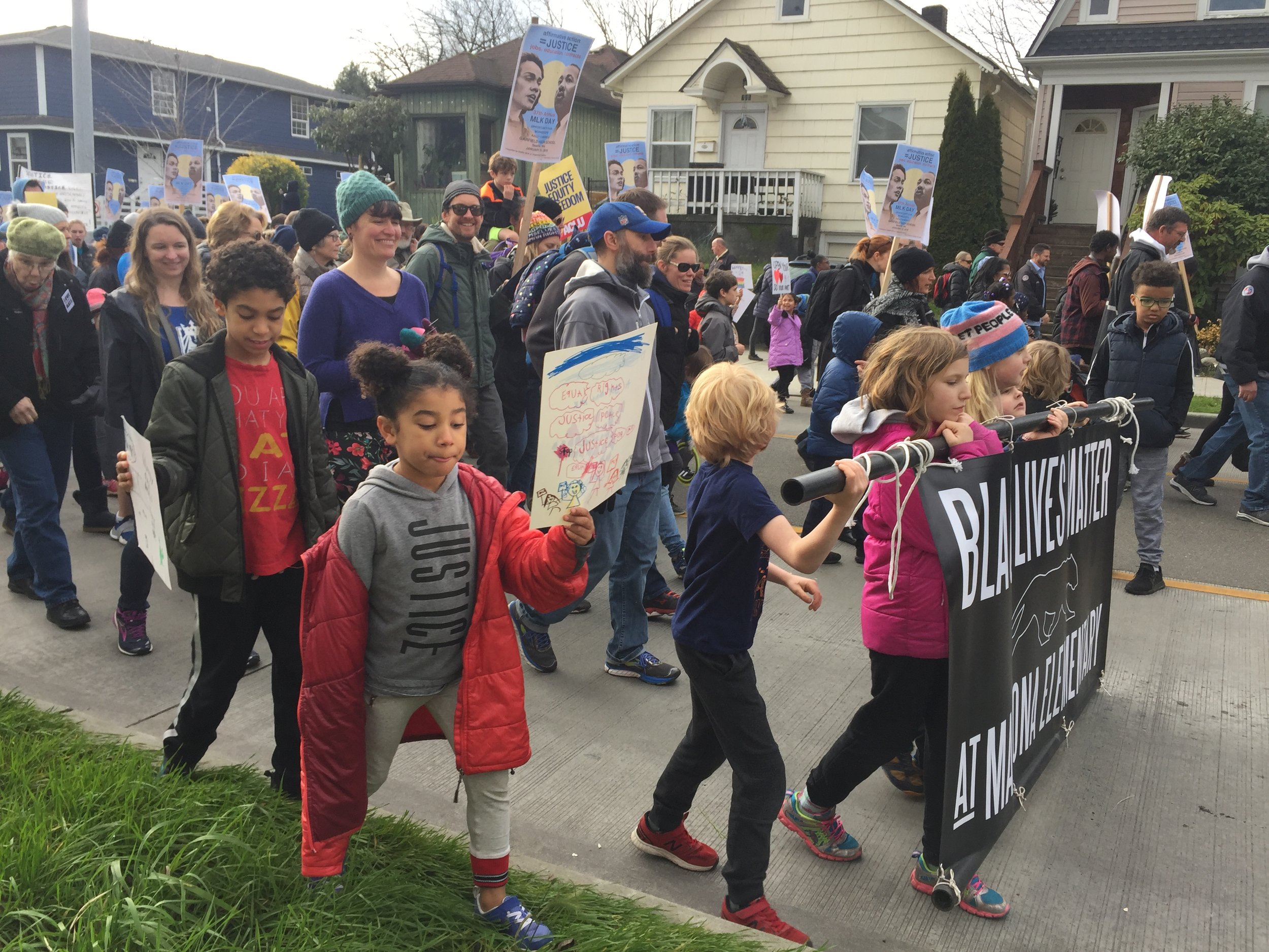 Marching with our school, neighbors, and friends!