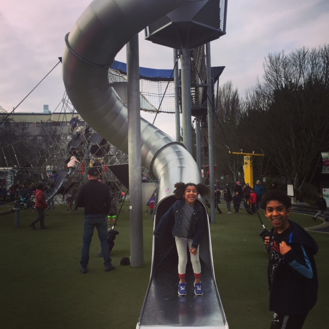 """Seattle Center Play Area. After climbing up the rope ladder, Elle was too scared to slide down the """"big slide,"""" but thanks to the coaxing of her brother Miles, they both made it down in one piece!"""