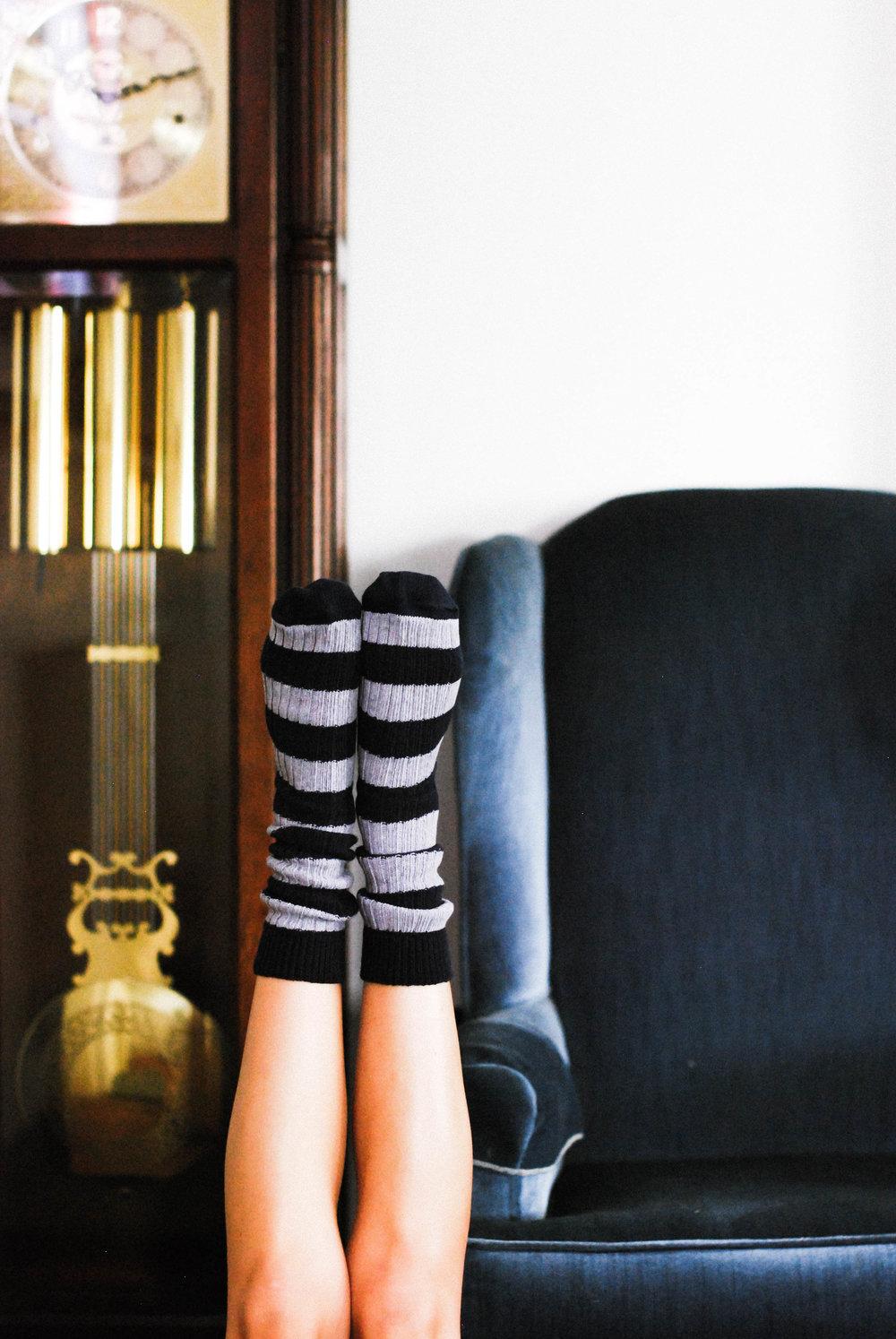 Sustainably Chic wearing Osom Brand socks