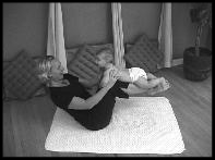 mom strengthening abs while interacting with baby