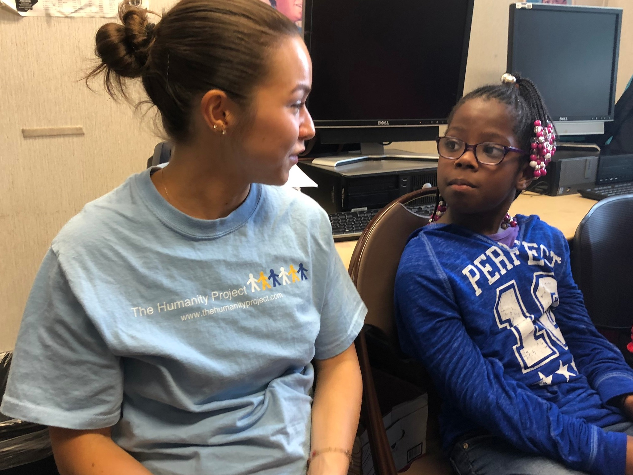 Our great summer intern, Noel Murray, with one of the girls