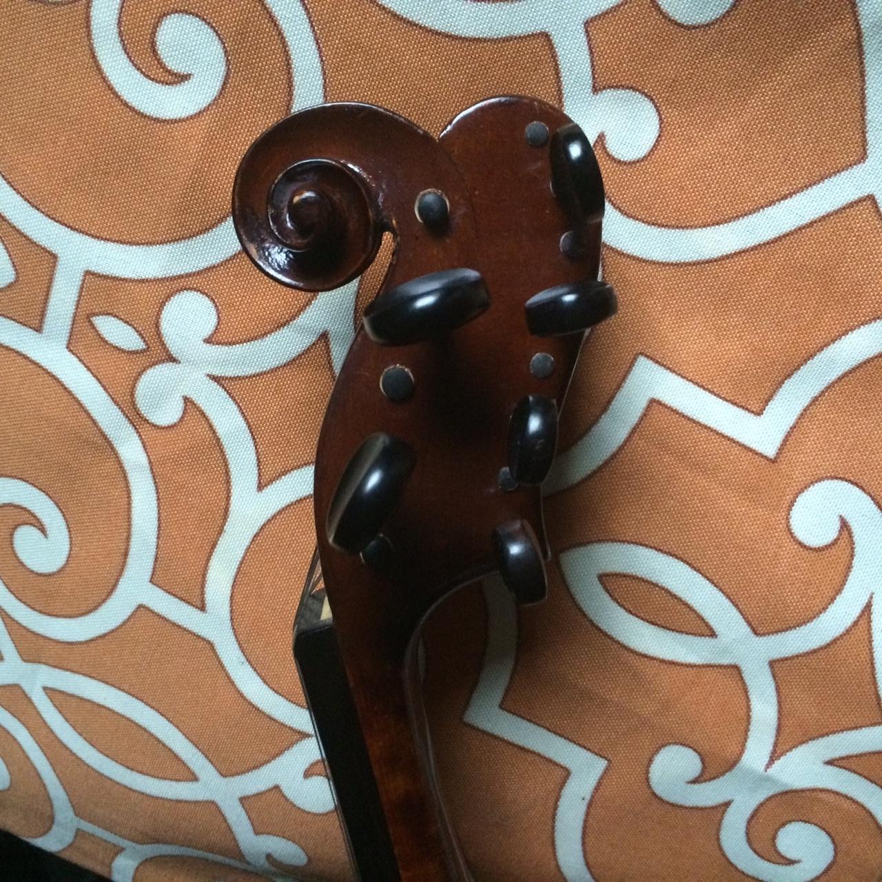 Detail of Five String/Eight Resonator Violin headstock.