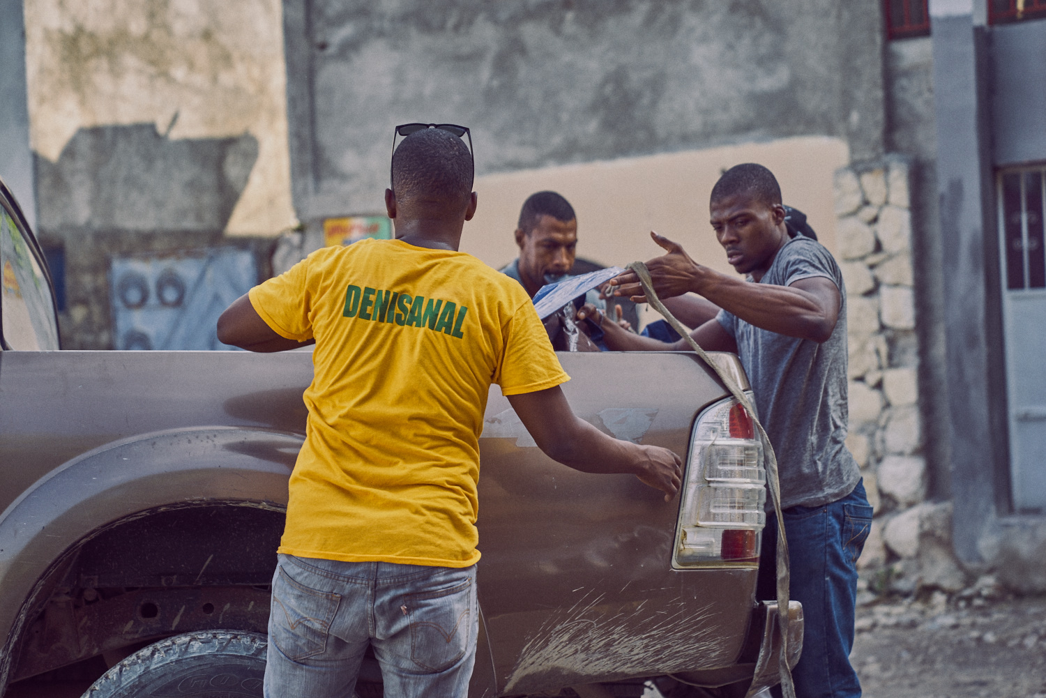 Rolin (pictured left) and Joachim (pictured right) work with the other men to prepare the care packages, medical equipment and other cargo for travel.