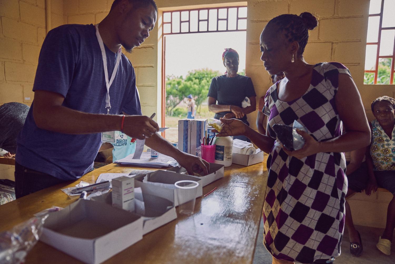ATR team member Desert dispensing prescriptions to a patient.