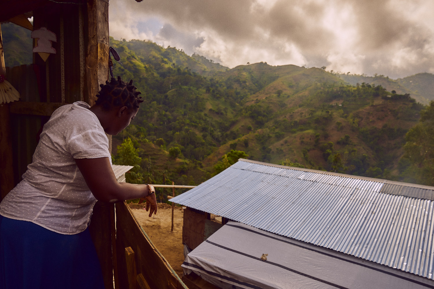 Chantal looking over the primary school structure below the church building. The new corrugated metal panels had been installed the week prior to our arrival.