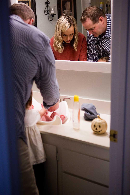Family Bathing Newborn Baby, Amy Wright Photography, Roseville Family Photographer