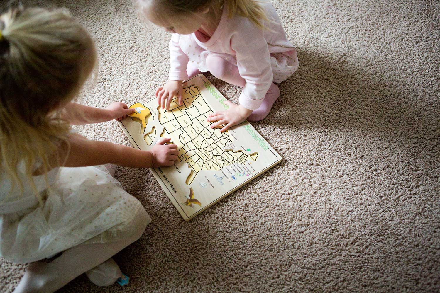 Sisters doing puzzle, Newborn, Amy Wright Photography, Roseville Family Photographer