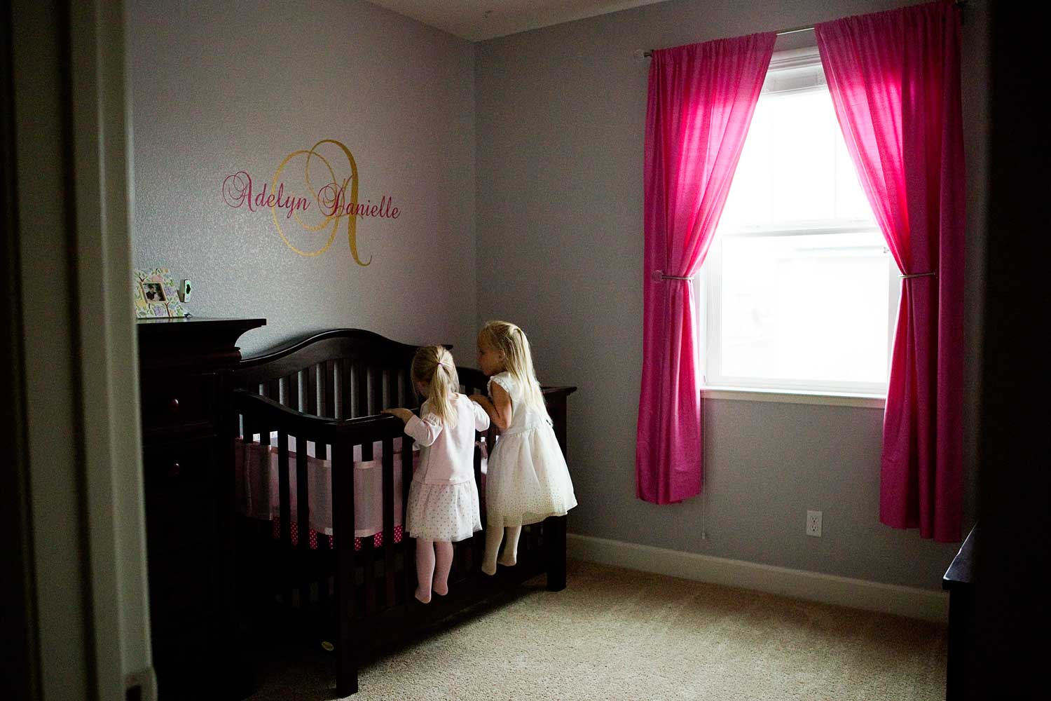 Sisters peeking in at Newborn, Amy Wright Photography, Roseville Family Photographer