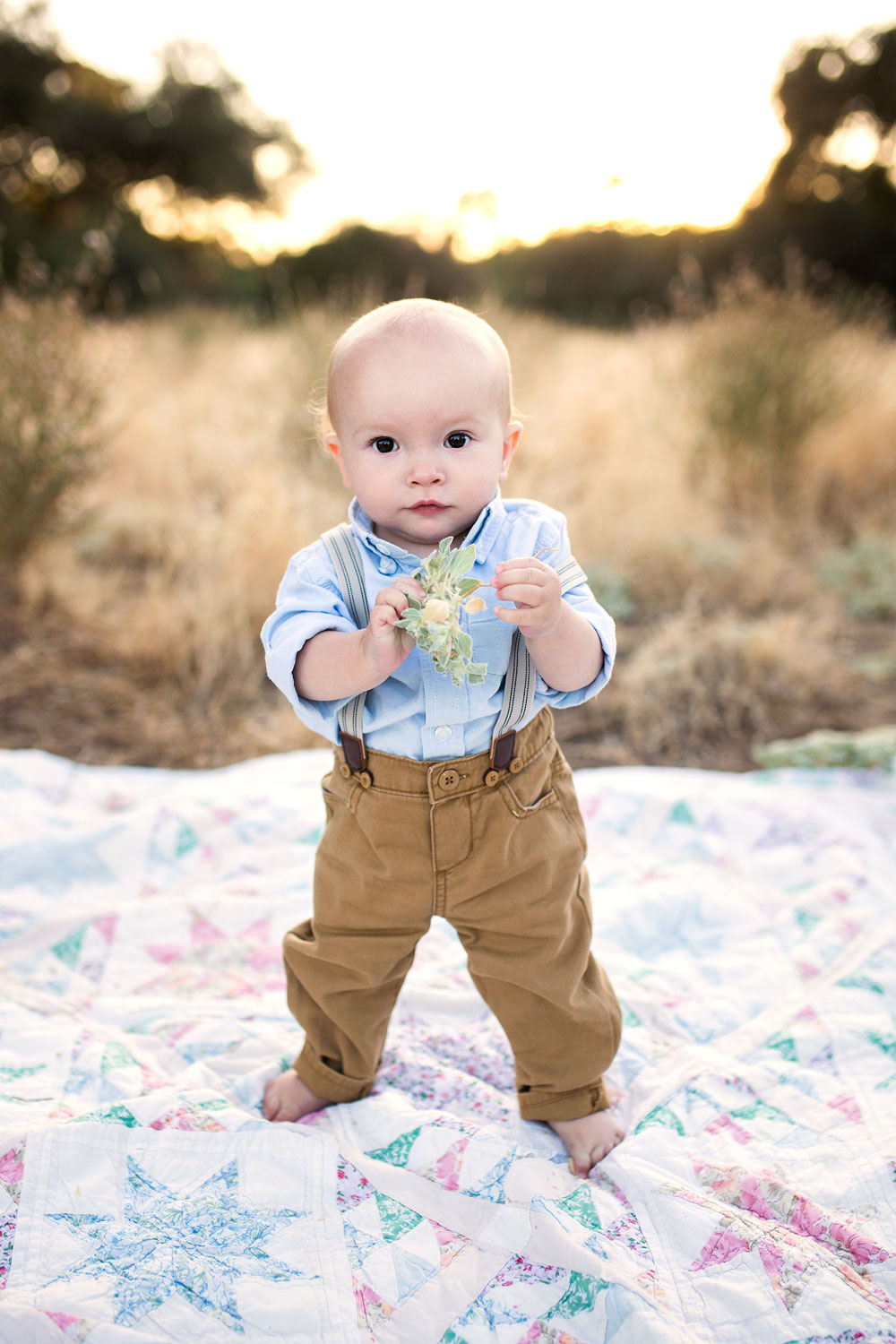 A One Year Old Baby Boy Standing On a Blanket Wearing Suspenders, Amy Wright Photography, Roseville Photographer