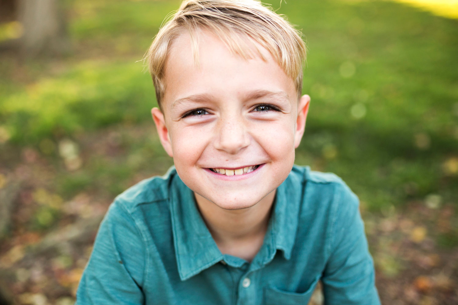 Boy Smiling at camera during family photo session with Amy Wright Photography in Sacramento California