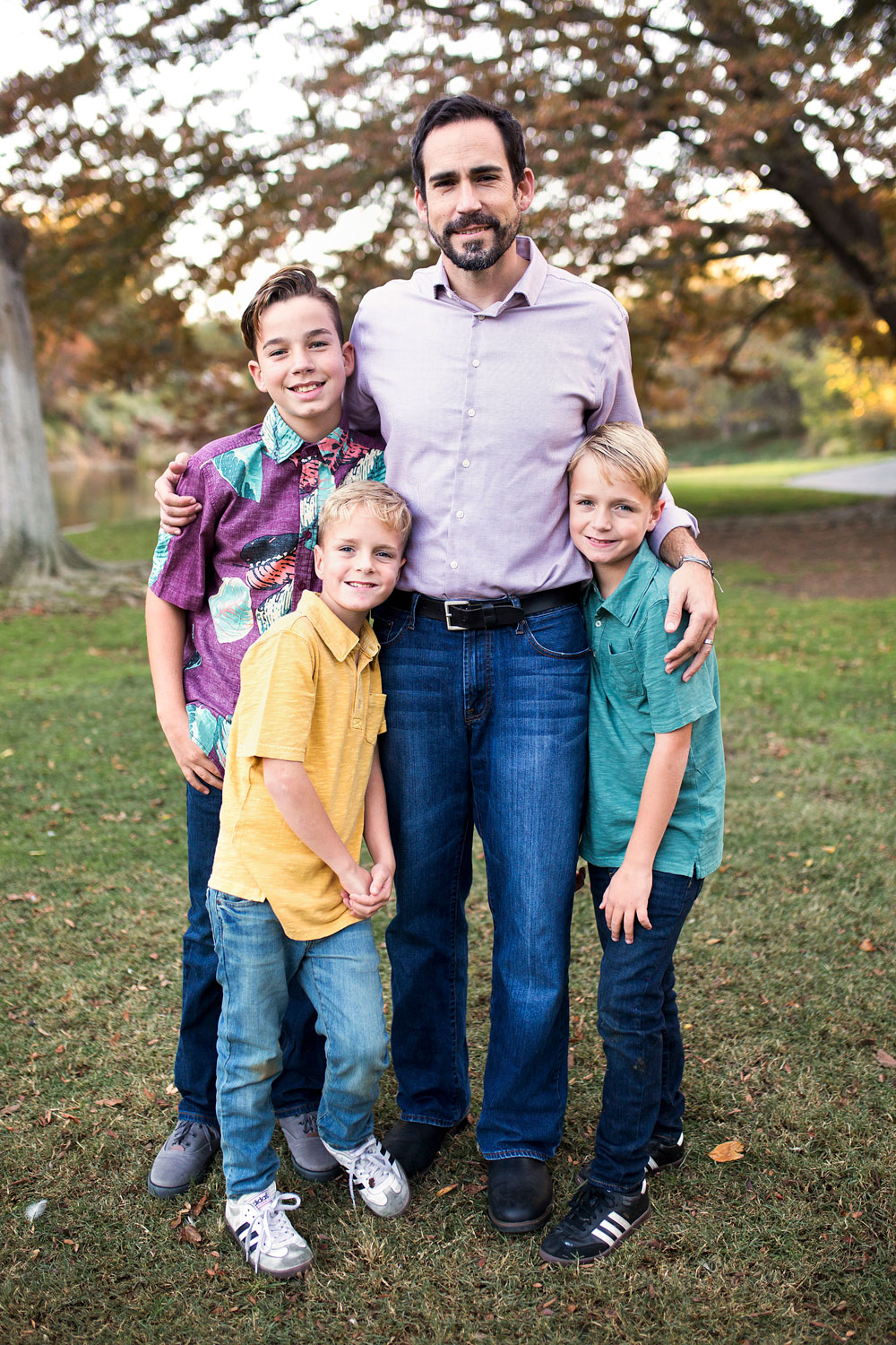 Father with arms around three sons during Sacramento Family Photo Session