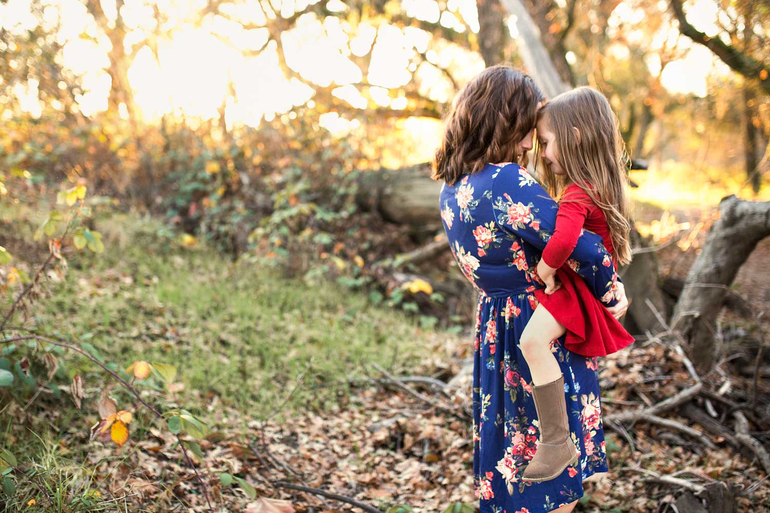 A mother holds her daughter close during a photo session in Roseville, California.