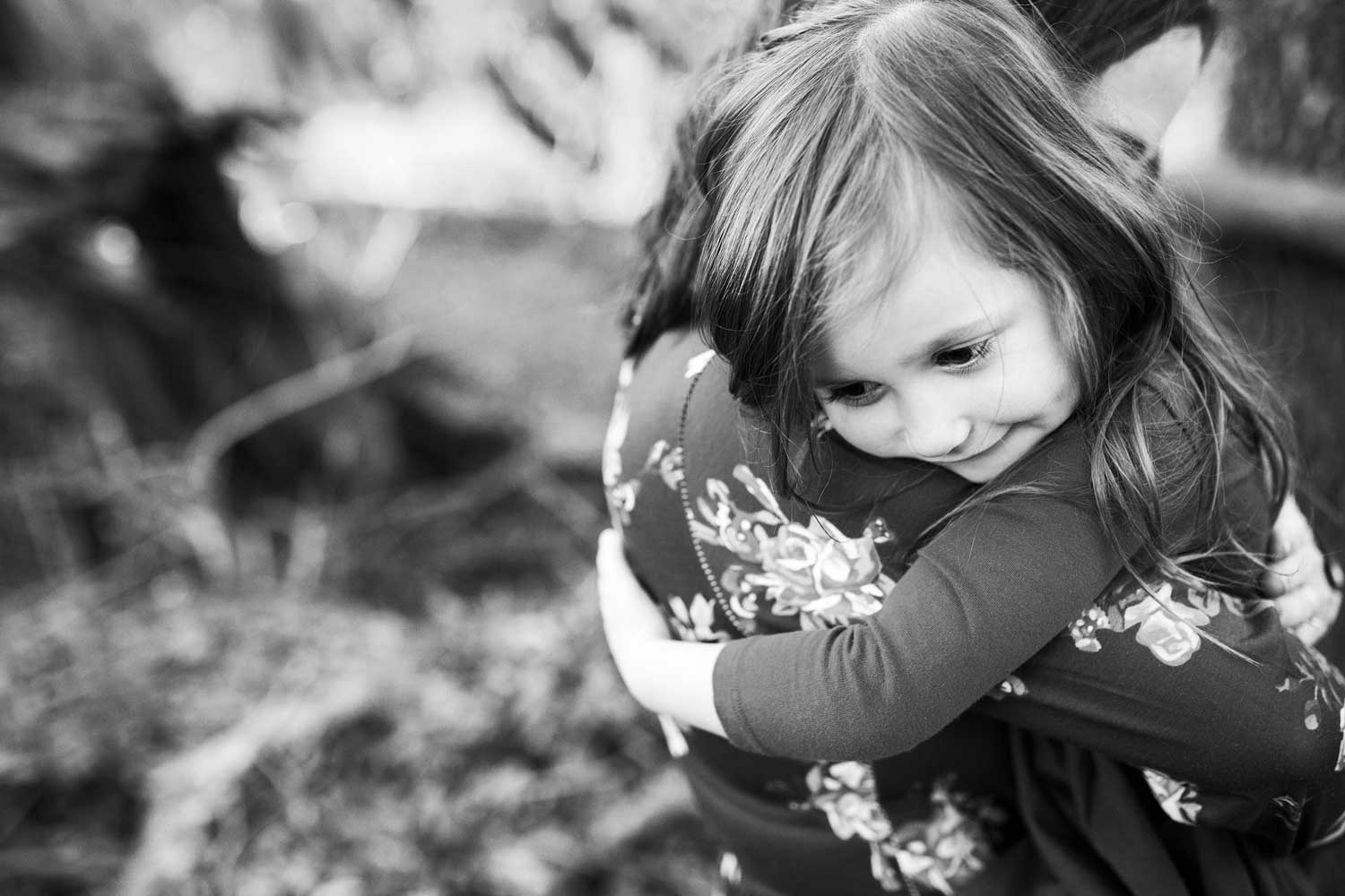 Daughter embraces mother as they hug during a family photo session in Roseville, California