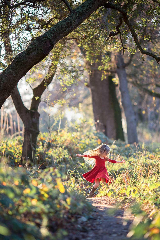 A girl twirls in a dress in Sacramento, California.