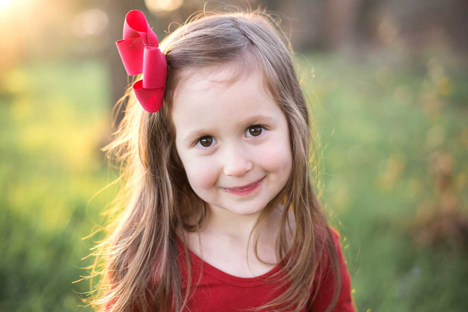 A girl sweetly smiles for the camera during a photo session in Roseville, California.