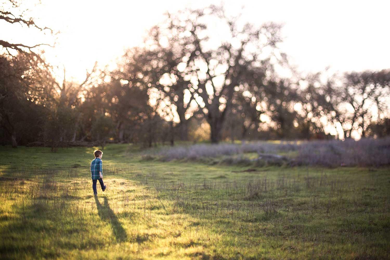 A boy is walking in a field in Roseville, California.