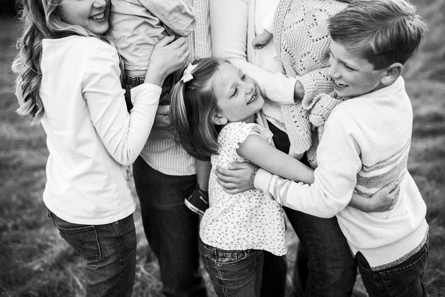 A family embraces and shows love to each other during a photo session in Roseville, California.