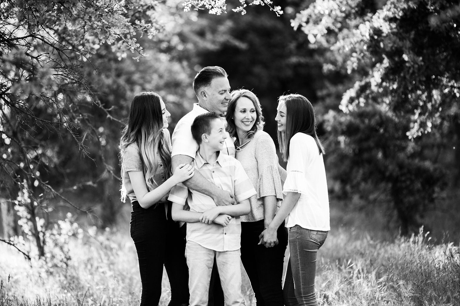 A family of five is happy together during a photo shoot with Amy Wright Photography in Sacramento, California.