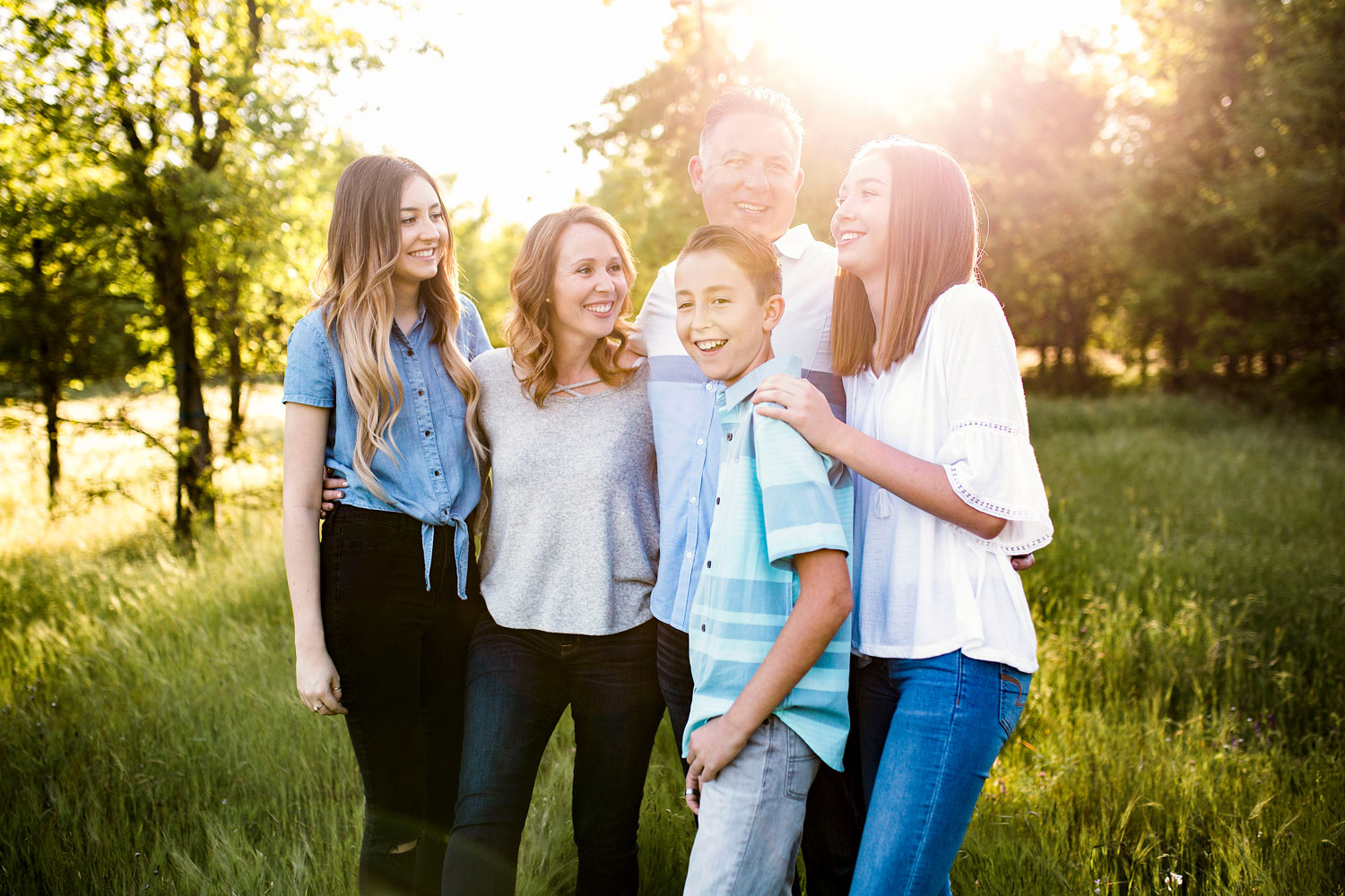 A family smiles and laughs together during their time with Amy Wright Photography in Northen California.
