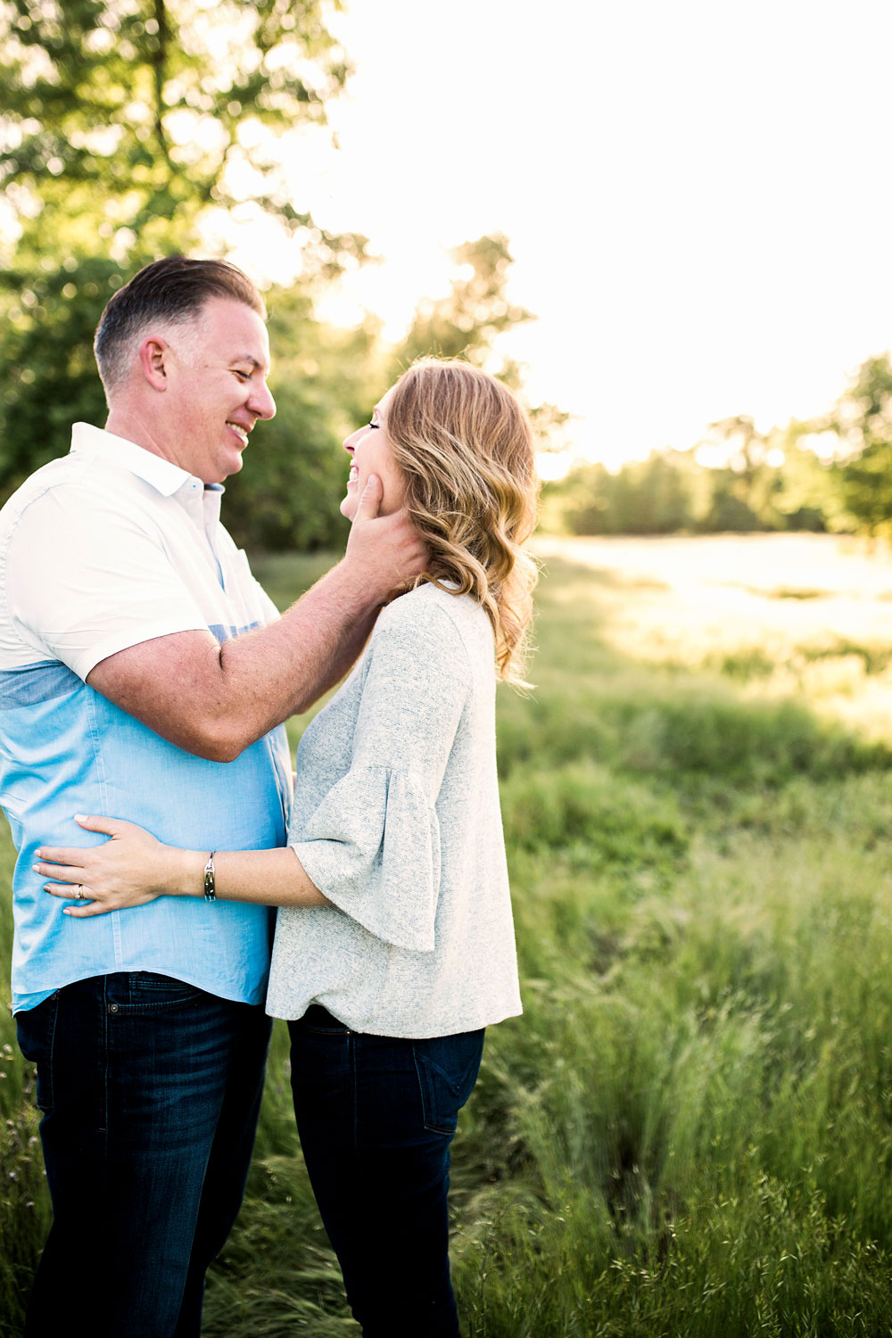 A couple happily embraces during a family photoshoot in Sacramento, California with Amy Wright Photography.