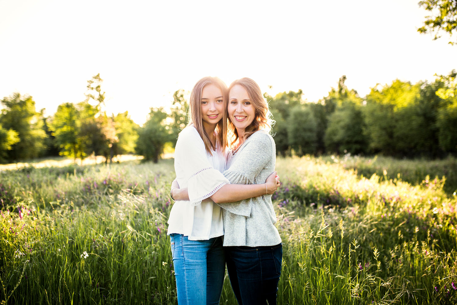 A mother and daughter hug and embrace during a family photo session in Roseville, California.