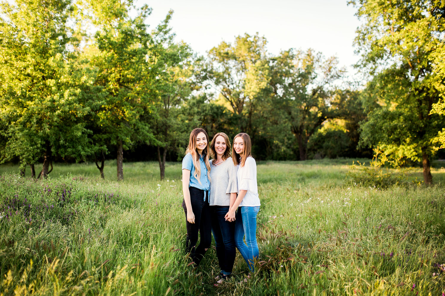 A mother and daughters pose during a family photo session with Amy Wright Photography in Sacramento, California.
