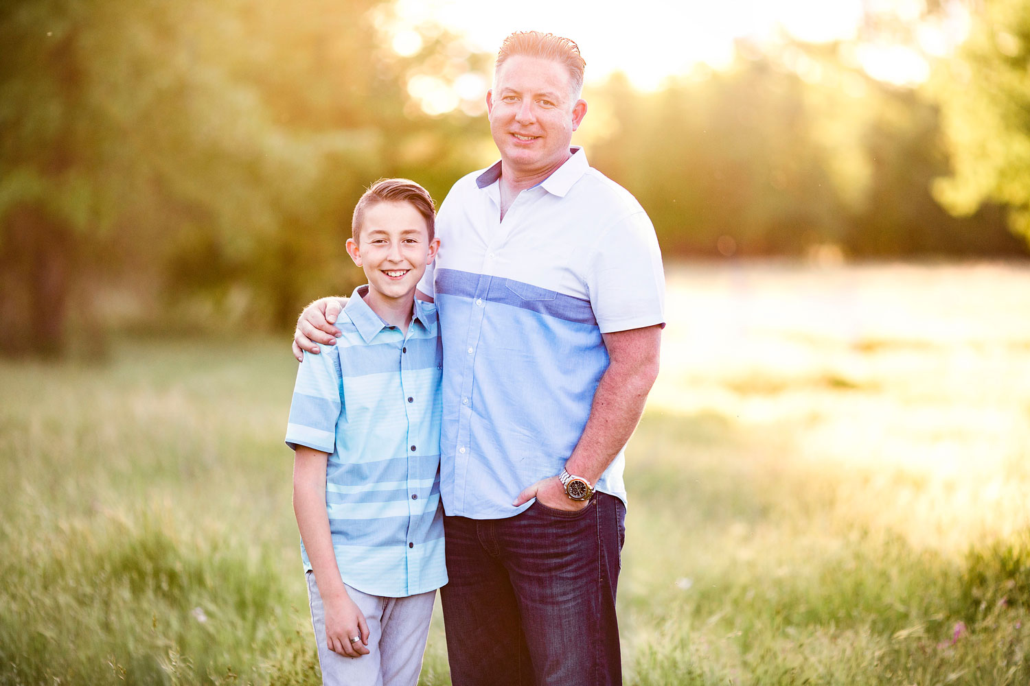 A father and son put arms around each other during a family photo shoot in Sacramento, California with Amy Wright Photography.