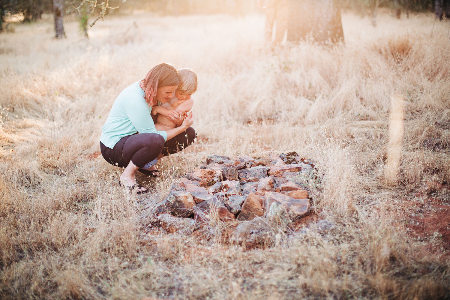 A boy and his aunt pay a visit to a pet grave during a lifestyle family photo shoot in Northern California.