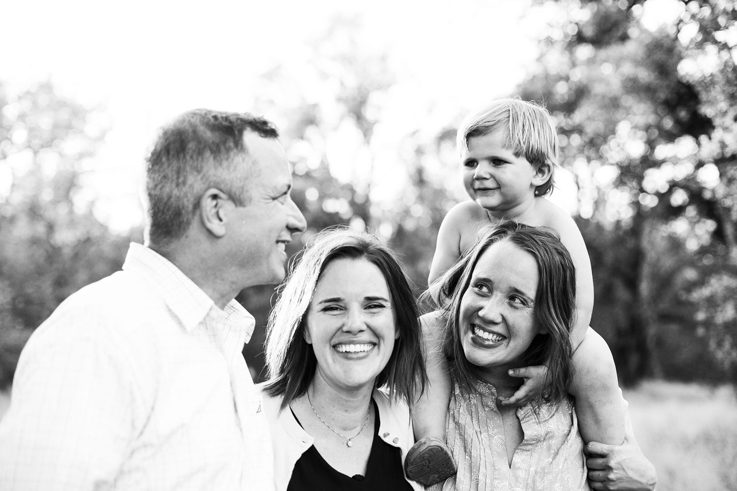 An Extended family laughs together during a photo shoot with Amy Wright Photography in Roseville, California.