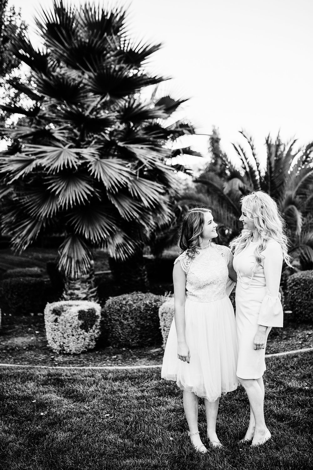 A mother and daughter look at each other during a lifestyle family photo session with Amy Wright Photography in Rocklin, California.