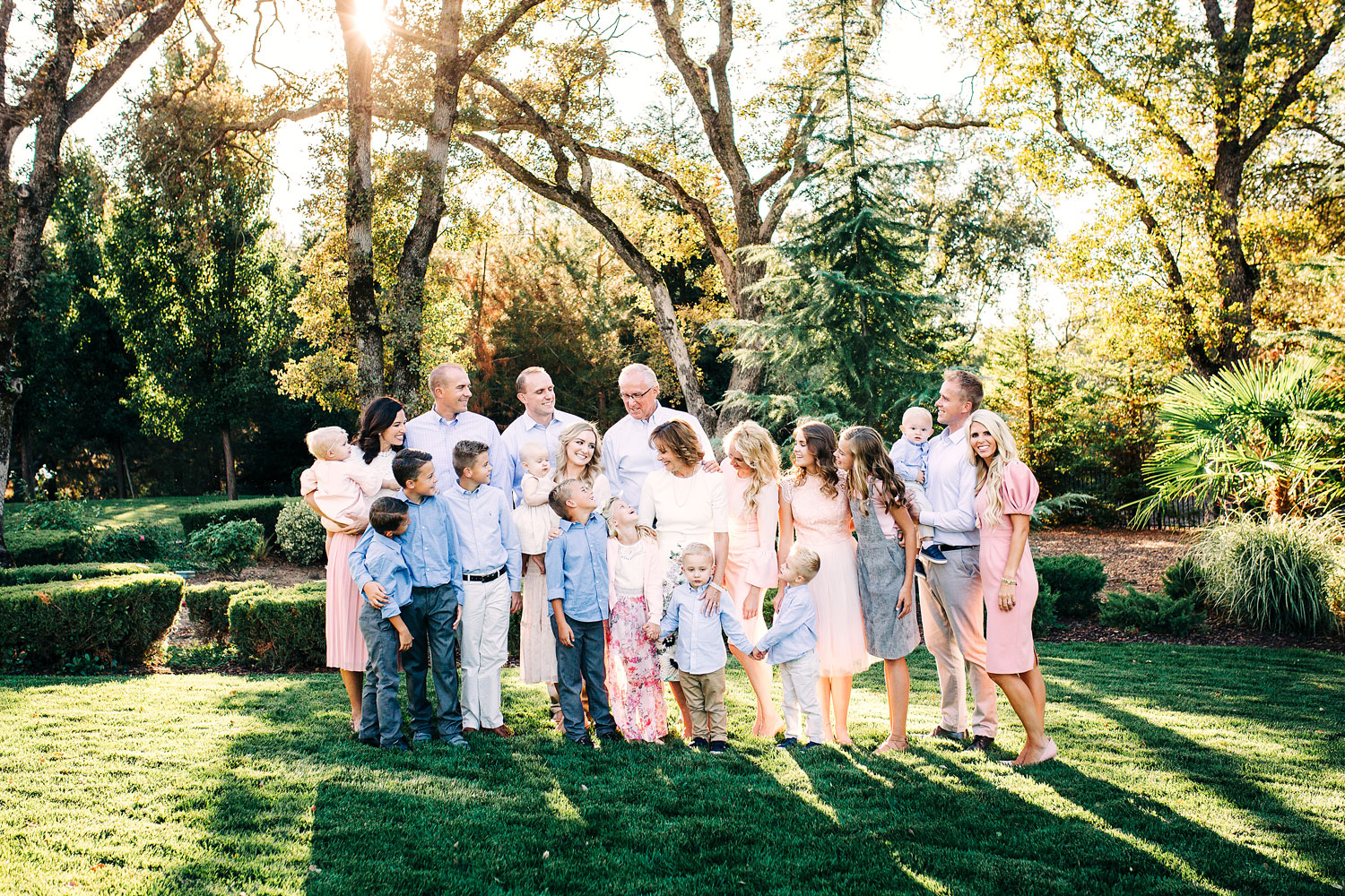 An extended family show love and embrace during their photo session with their photography, Amy Wright Photography, who is based out of Roseville, Rocklin, and Sacramento, California.