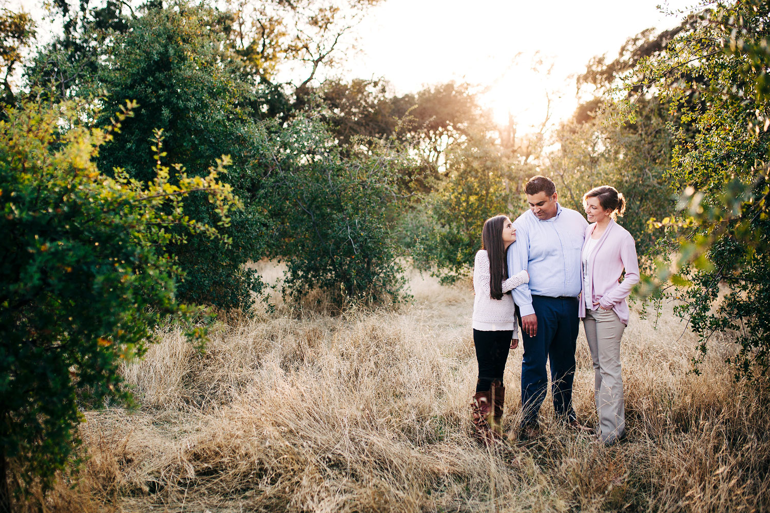 A family of three connects with one another during a family photo session with Amy Wright Photography based out of Roseville, California.