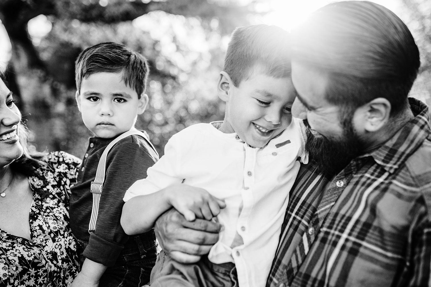 A father and son share a special moment during a family photo session with Amy Wright Photography in Sacramento, California.