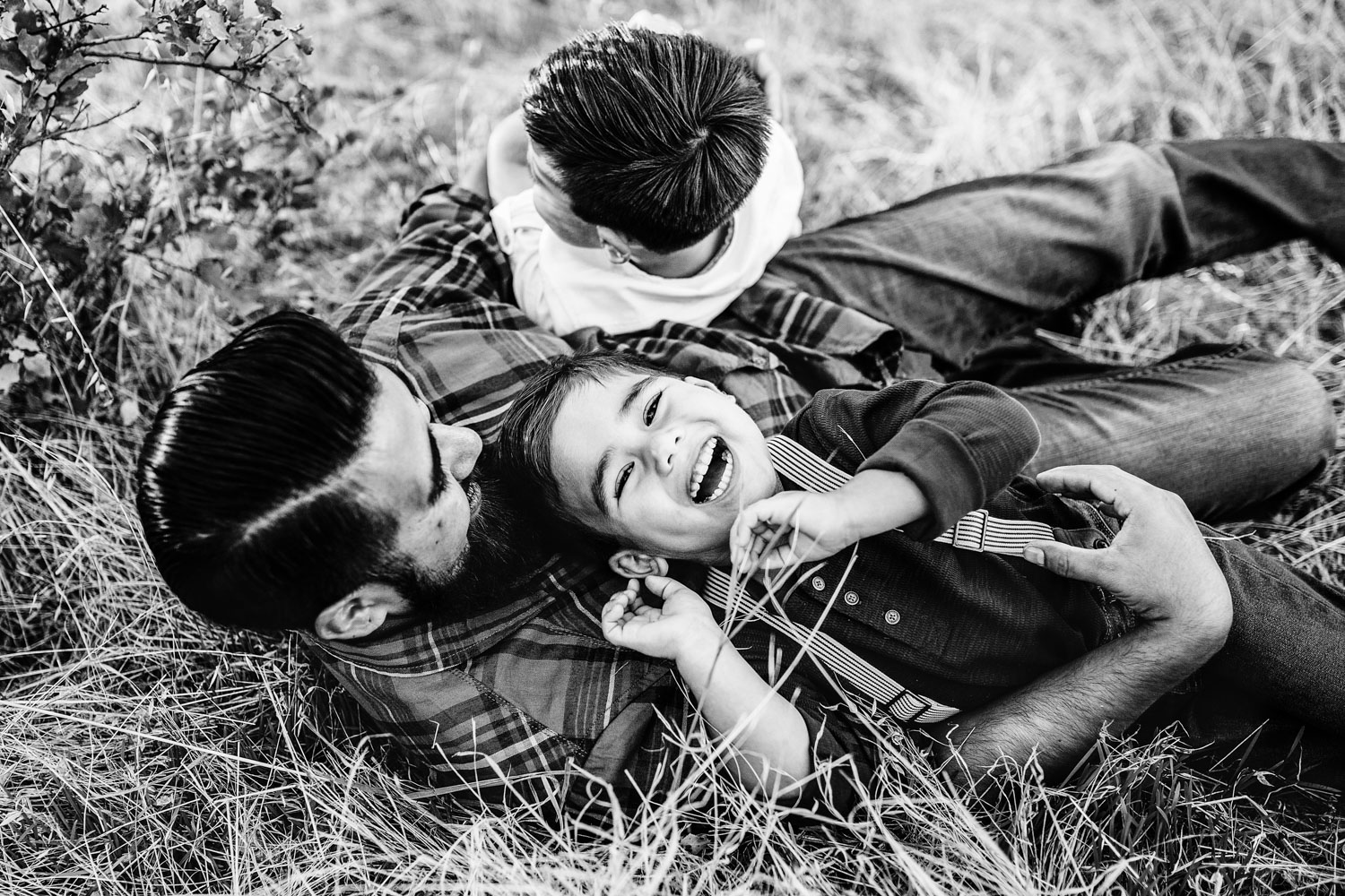 Two boys and their father play and laugh together during family pictures with Amy Wright Photography, based out of Roseville, Rocklin, and Sacramento, California.