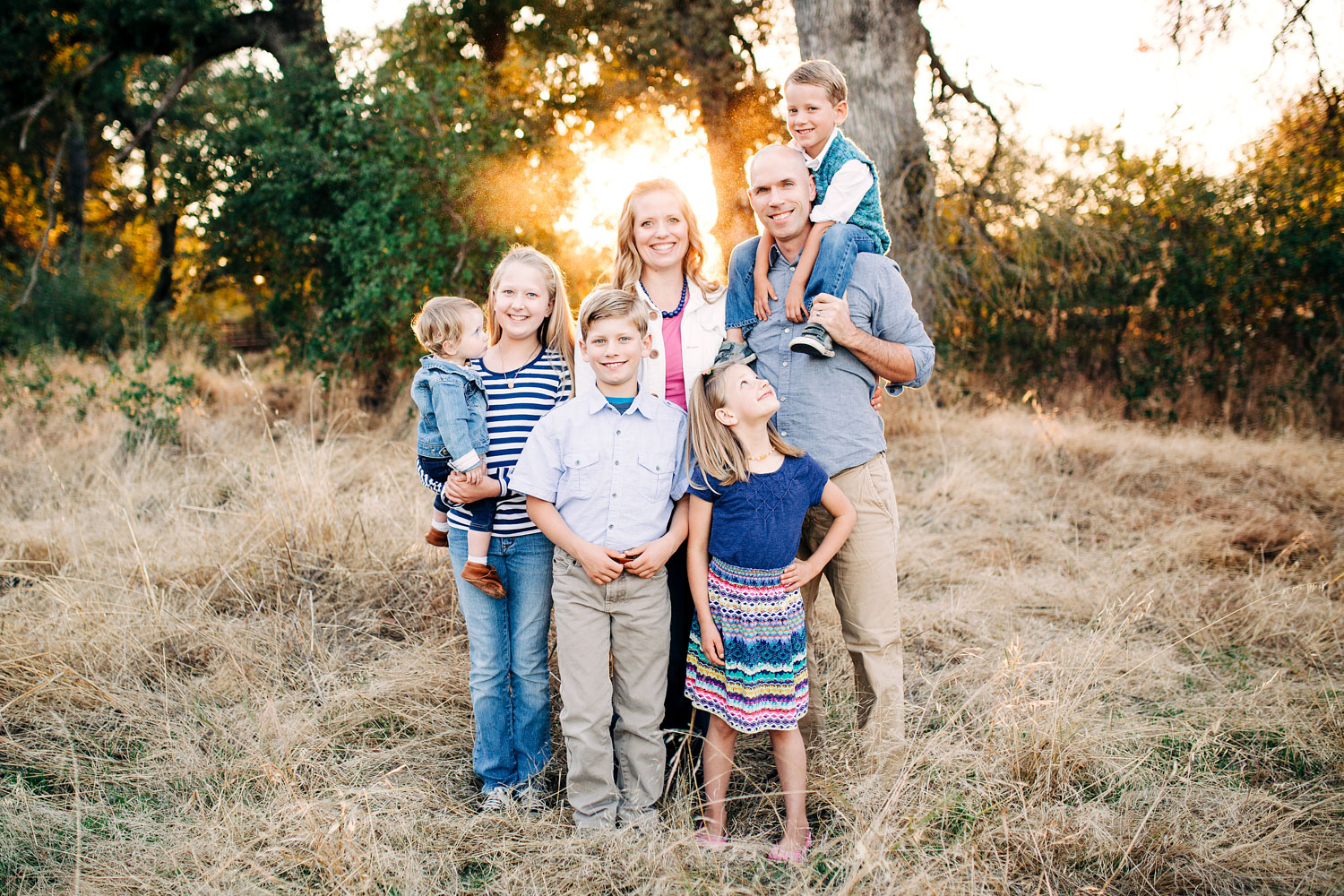 A family of seven gets close for family pictures with their photographer, Amy Wright, in Roseville, California.
