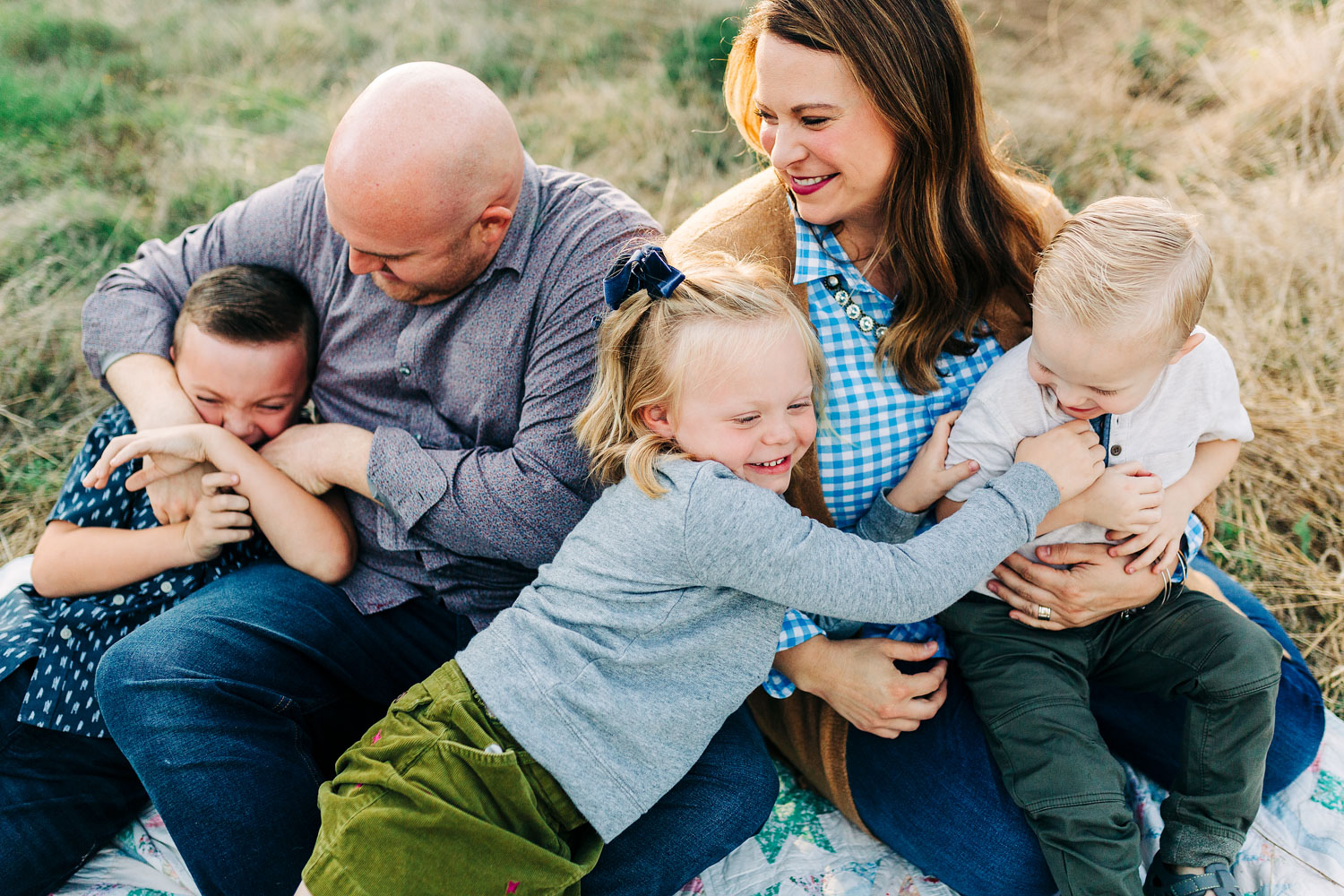 A family of five snuggles together during their family photo session with Amy Wright Photography based out of Sacramento, California.