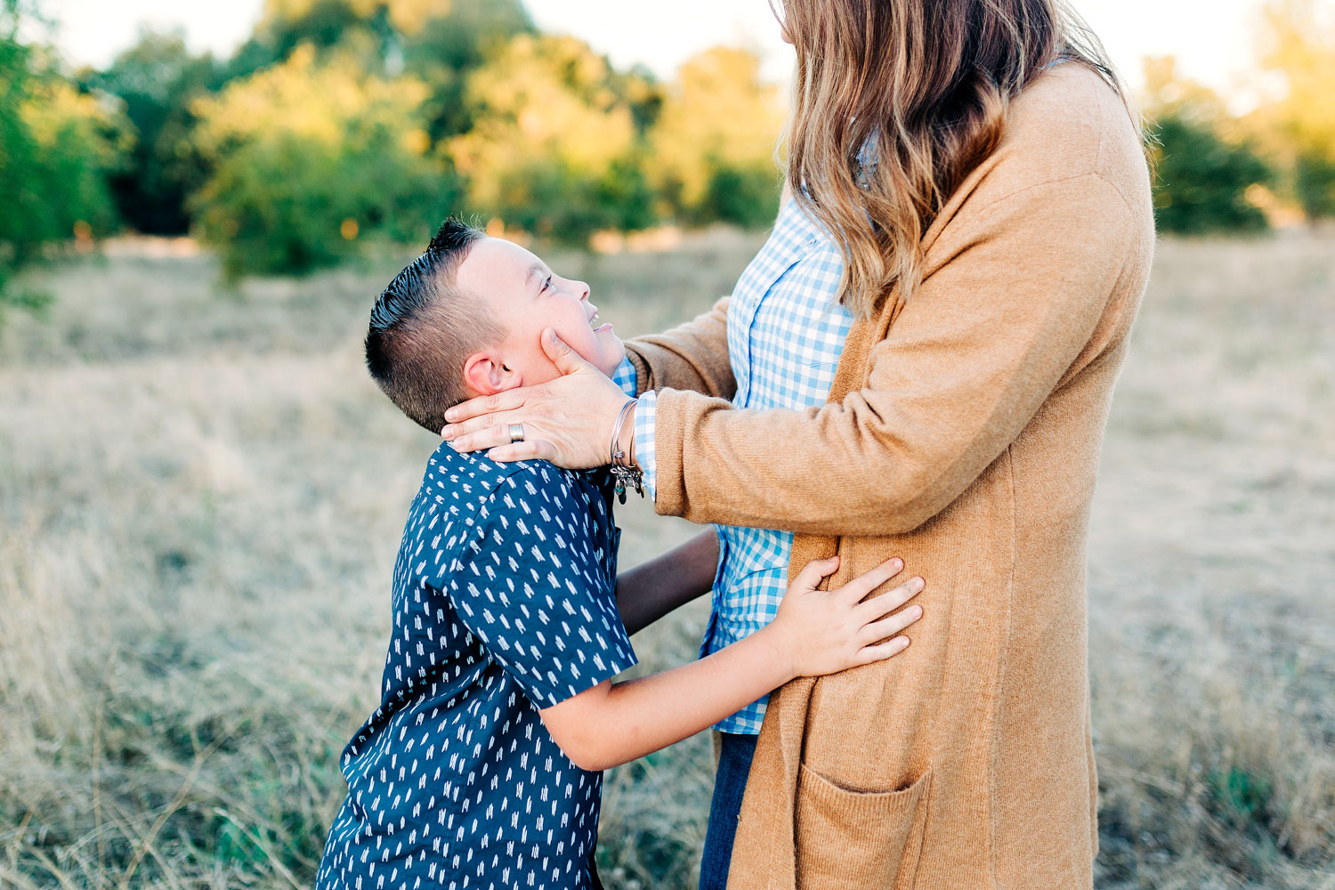 A mother and her son show love with each other during a family photo session with their photographer, Amy Wright, based out of Sacramento, California.