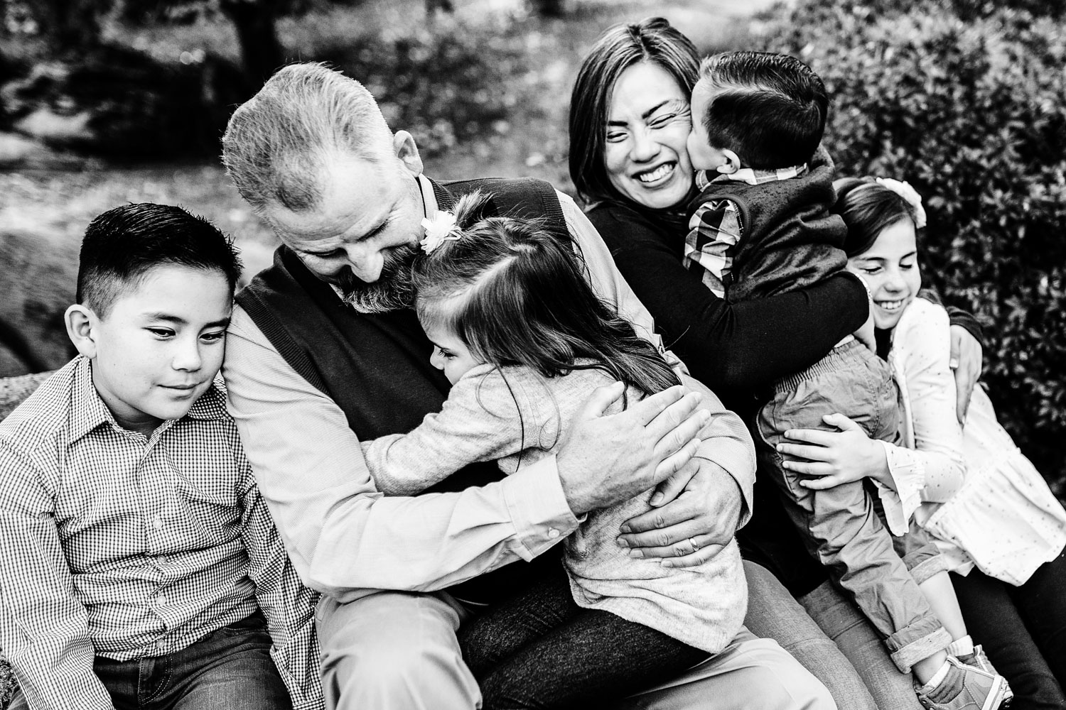 A family loves and cuddles each other during family pictures with Amy Wright Photography in Sacramento, California.
