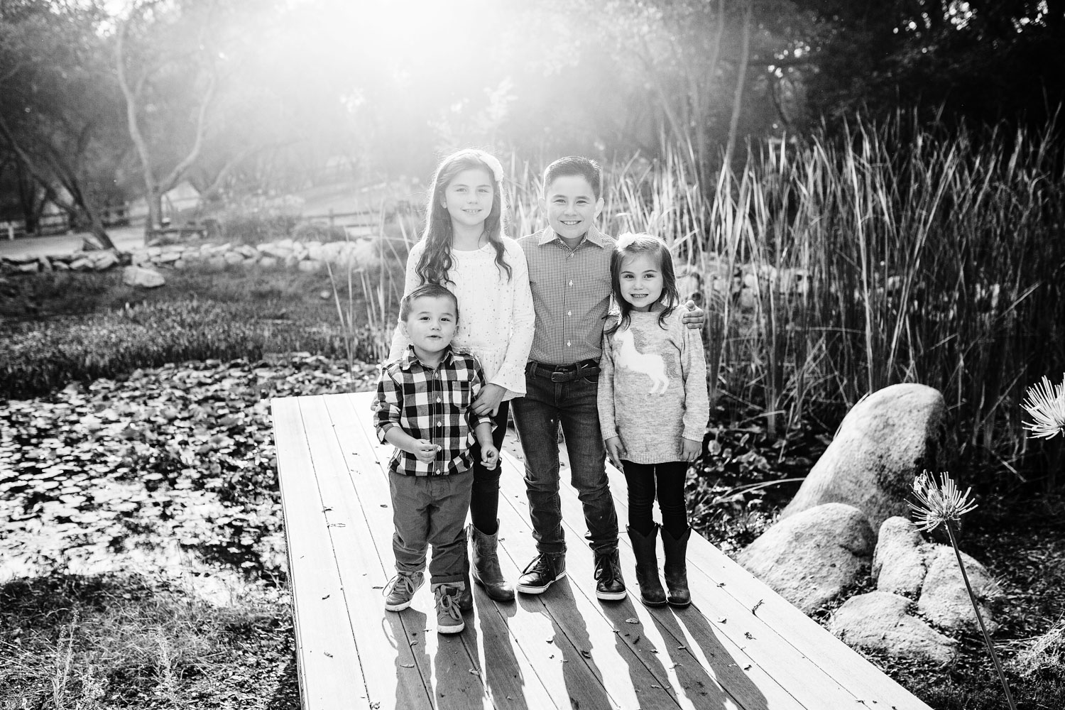 Four siblings pose at their home for a lifestyle picture with Amy Wright, who is based out of Roseville, California.