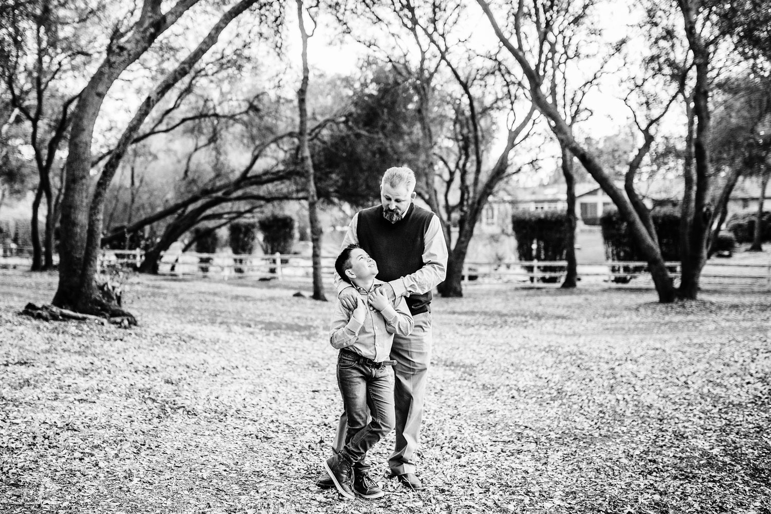A father and son stand together during an at home family photo session with photographer Amy Wright in Granite Bay, California.