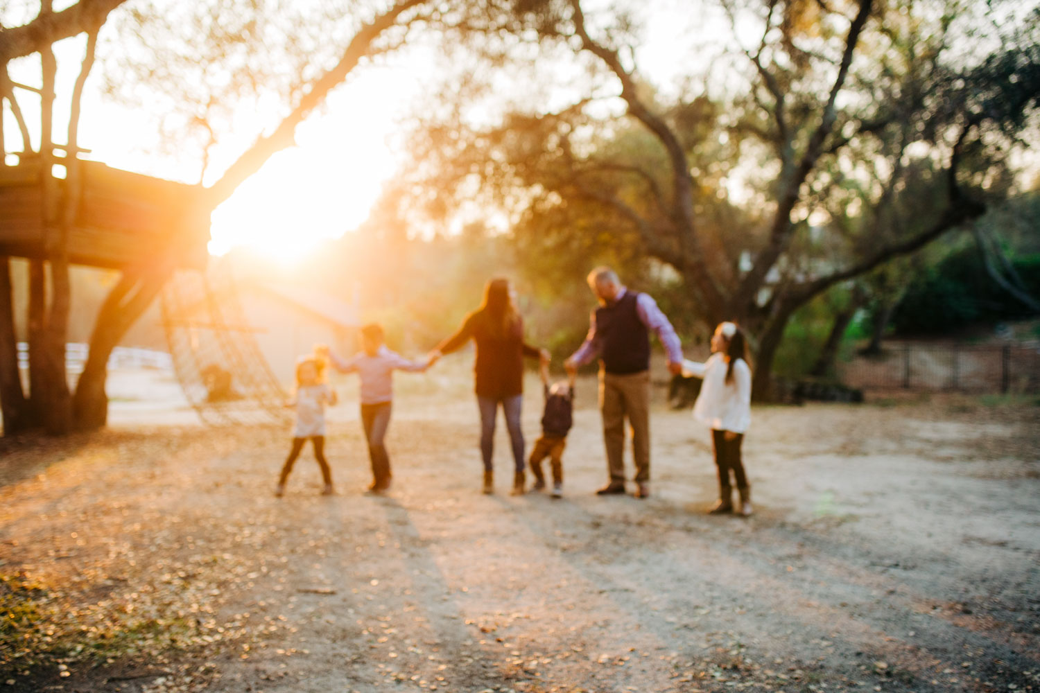 An intentional blurred family photo is created, filled with light and happiness, in Roseville, California with Amy Wright Photography.