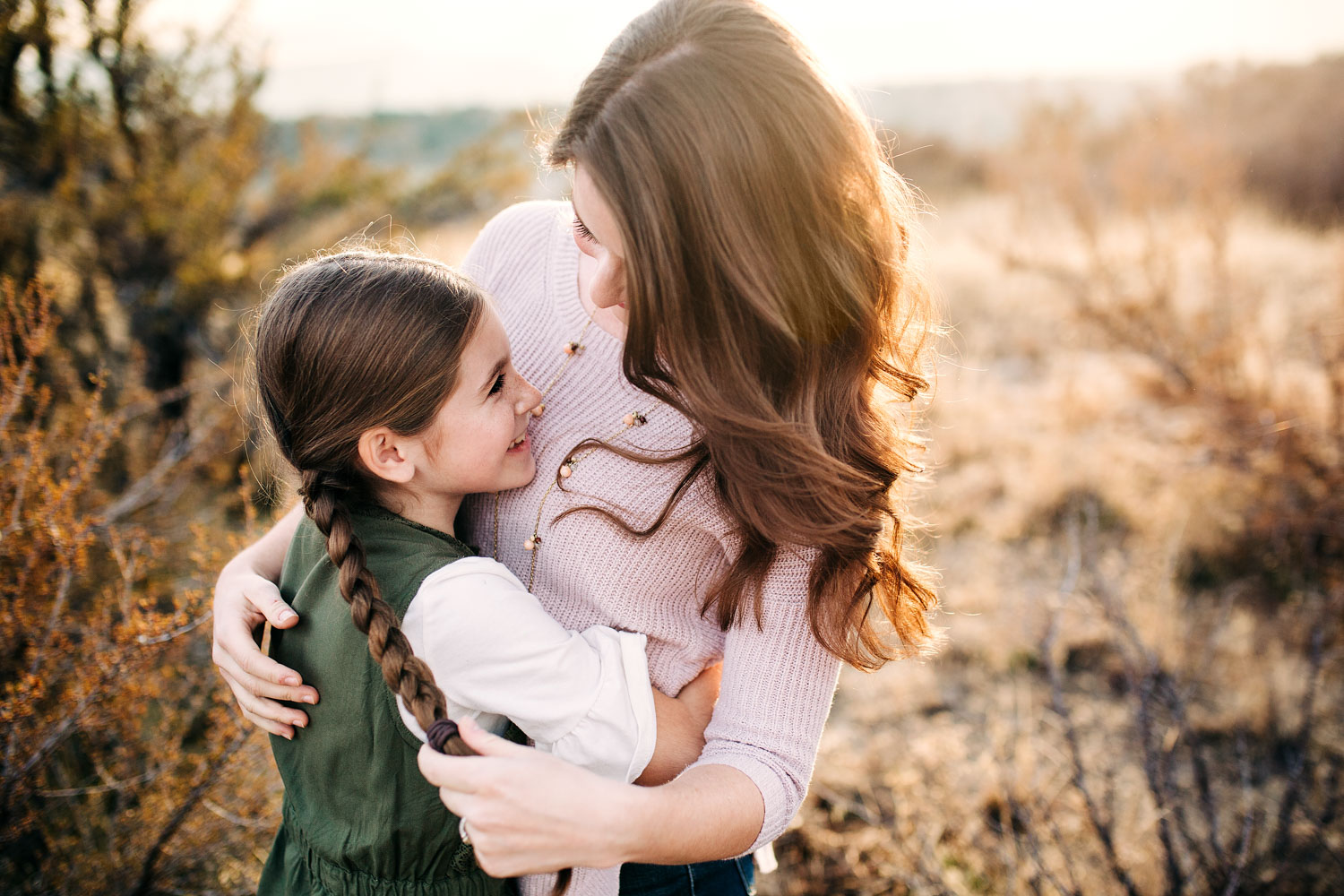 A mother and her daughter embrace and hug during a family photo session in Roseville, California with Amy Wright Photography.